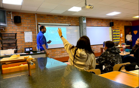Mr.Schober teaching his geometry class to 10th Grade students.