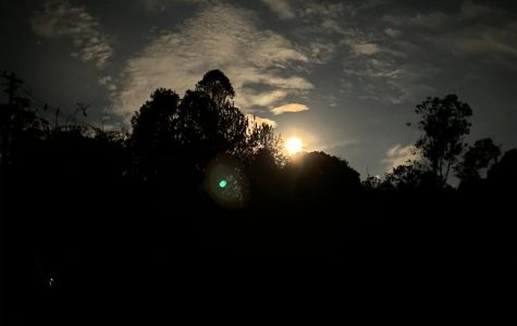 The dazzling moon, highlighting the clouds and outlining the trees, was captured from the hammock on April 7th, 2020, in the countryside of El Retiro, Antioquia.