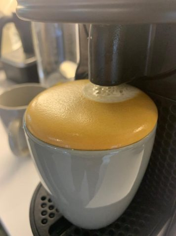 An appreciation shot of a delightful brimming nespresso coffee.