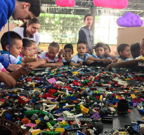 TCS students teaching kids LEGO from surrounding schools.
