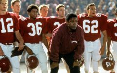 Coach Boone (portrayed by Denzel Washington) looking on from the sidelines along with his team behind him during a regular season game.