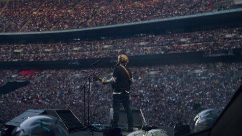 Ed Sheeran plays to a prepandemic packed crowd at Wembley Stadium, London, England.